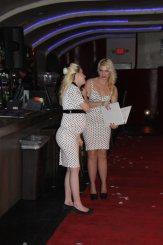 2 women in white dresses