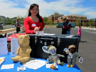 Woman with Footlocker and military stuffed toys