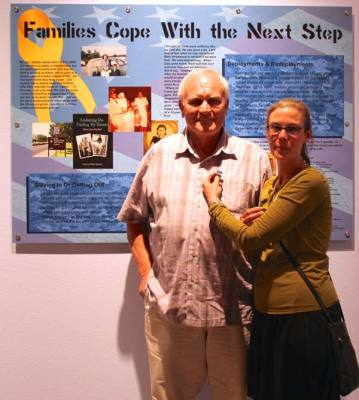 Circen with man in front of Families Cope with the Next Step Panel