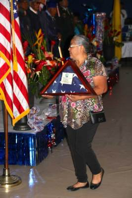 woman in flowered top with memorial flag