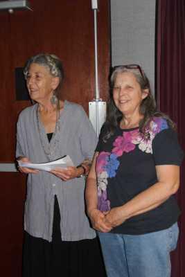 Woman holding script with Caroline LeBlanc