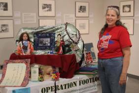 Caroline LeBlanc with Operation Footlocker display at Salute to Heroes Veterans Day Celebration 2014
