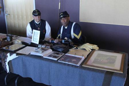 Two men dressed as Civil War soldiers at booth with memorabelia
