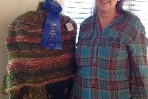 Caroline LeBlanc with prize-winning knitted shawl