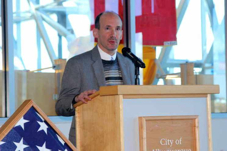 Man at podium at Salute to Heroes Veterans Day Celebration 2014