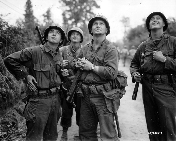 US soldiers watch as Allied bombers approach St. Lo. (US Archives)