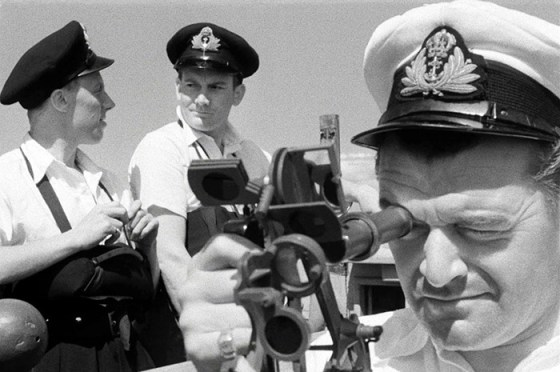 "Jack Hawkins plays the skipper of HMS Compass Rose in the gritty 1954 classic ""The Cruel Sea""."