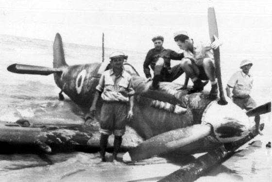 Israeli troops survey the wreckage of an Egyptian Spitfire. Both the Israelis and the Egyptians maintained squadrons of Spits -- one several occasions, the aircraft did battle with each other.