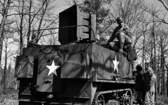 "Troopers from the so-called ""Ghost Army"" with one of their loudspeaker carrying halftracks. Vehicles like these were used to perform ""sonic deception"" missions in which the sounds of entire tank divisions were broadcast across the battlefield to fool the enemy. Image courtesy Plate of Peas Productions and GhostArmy.org."