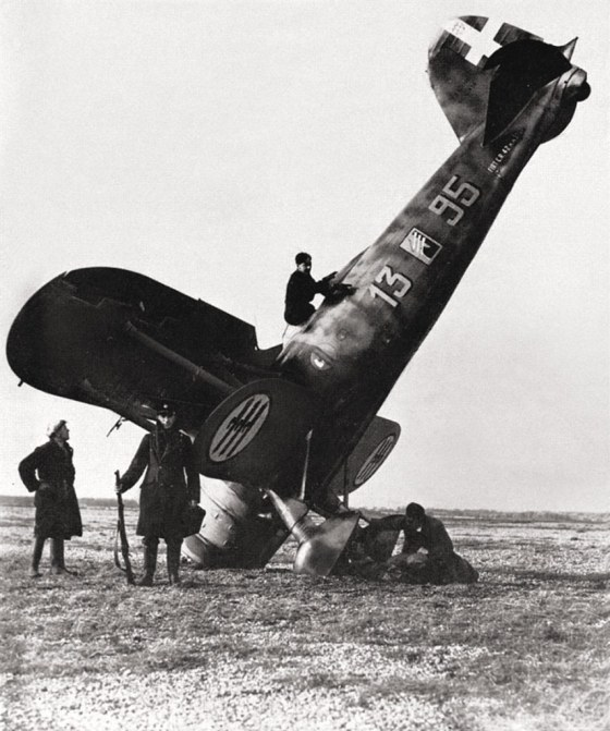 Men of the Home Guard stand watch over a crashed Fiat Falco somewhere in southern England.