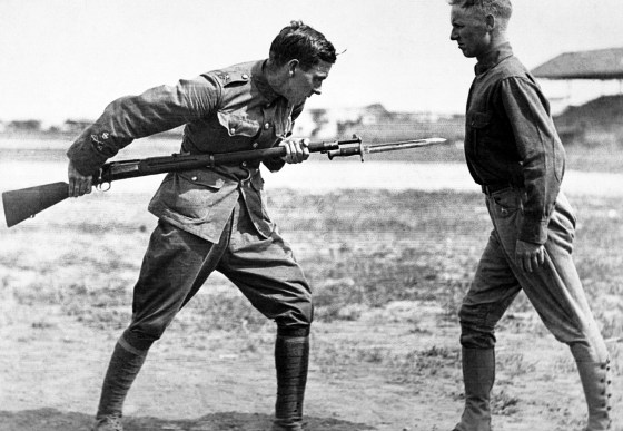 A World War One era doughboy trains with a bayonet. By the 1940s, bayonet charges were mostly a thing of the past. There were a few exceptions of course.
