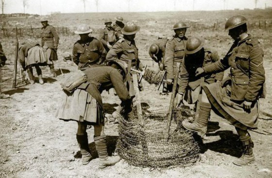 A Black Watch wiring party waits for dusk before heading out into No Man's Land.