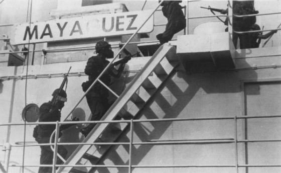 U.S. troops storm the Mayaguez.