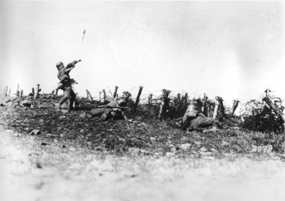 A stormtrooper hurls a grenade at an Allied trench.