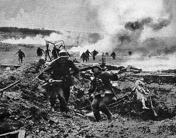 German troops charge past the body of a fallen French soldier.