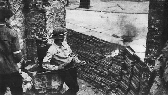 A resistance fighter uses a K pattern flamethrower