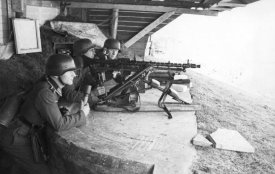 German troops man an MG-34 somewhere along the coast of France,