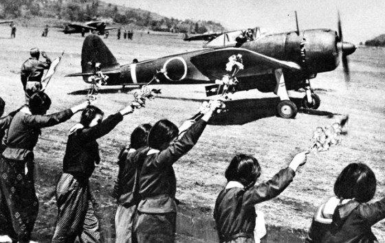 Japanese school children wave farewell to Kamikaze pilots.