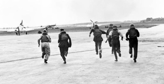 British pilots dash to their waiting Spitfires during the Battle of Britain.