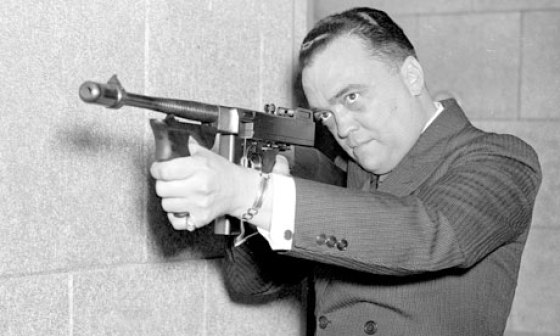 J. Edgar Hoover examines one of the FBI's new Thompsons.