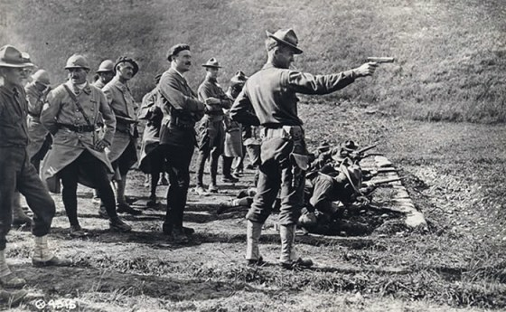 A U.S. Marine demonstrates a Colt .45 in France during World War One (Image source: Fair Use/Public Domain)