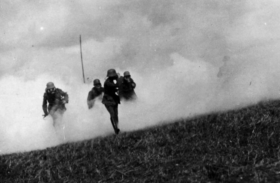 Germany stormtroopers emerge from a wall of gas towards Allies lines, March 1918.