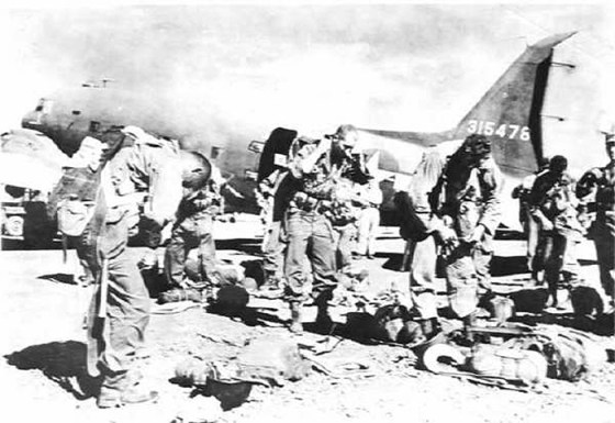 Paratroopers of the 11th Airborne prepare for their assault on Los Baños, February, 1945. (Image source: WikiCommons)