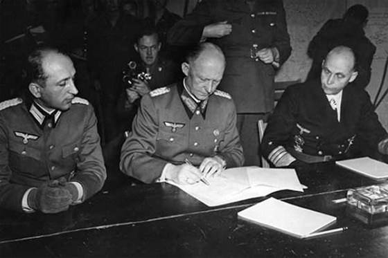 Alfred Jodl signs the German surrender at 2:41 a.m. in Reims, France. The Allies wanted to pretend this never happened (at least for a full day)