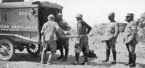 French soldiers load their wounded comrades aboard an American volunteer ambulance. (Image source: WikiCommons)