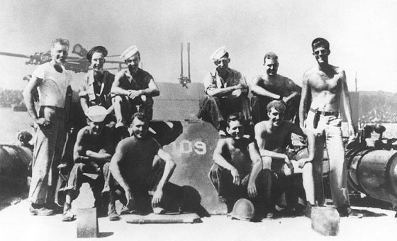 JFK with the crew of PT-109. Kennedy is on the far right. (Image source: WikiCommons)