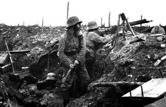 German troops prepared to fend off an Allied assault in the midst of a chemical attack. (Image source: German Federal Archive)