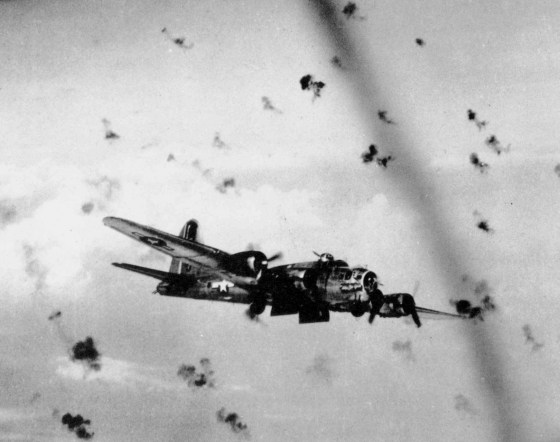 An American B-17 flies through a cloud of German anti-aircraft fire. (Image source: WikiCommons)