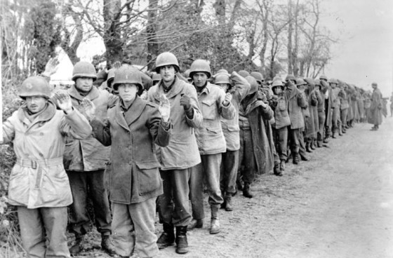 American troops captured during the 1944 Ardennes Offensive. (Image source: WikiCommons)