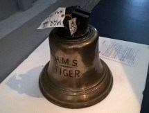 A ship's bell from HMS Tiger. The British battlecruiser was hit six times in seven minutes at Jutland. (Image Source: Scott Addington)