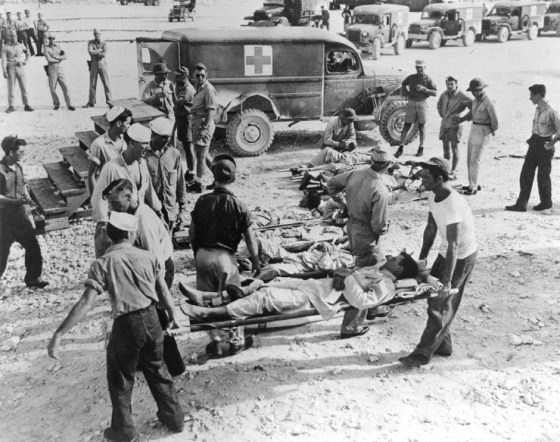 Some of the survivors of the USS Indianapolis are treated on shore after their harrowing ordeal in the Pacific. (Image source: WikiCommons)