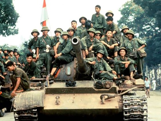 NVA troops ride through the streets of the South Vietnamese capital.