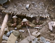 Canadian troops mug for the camera from inside a captured enemy dugout. (Image source Canada. Dept. of National Defence/Library and Archives Canada via the Vimy Foundation)