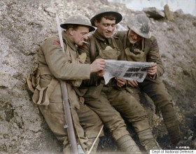 Canadian troops on the Western Front take a break from the action to catch up on current events. (Image source Canada. Dept. of National Defence/Library and Archives Canada via the Vimy Foundation)