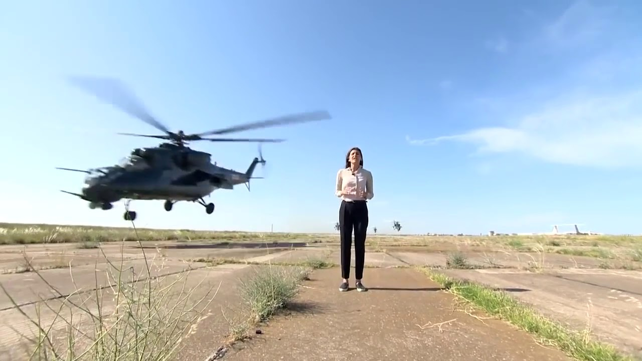 Female reporter almost decapitated by a helicopter