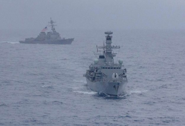 USS McCampbell and HMS Argyll maneuver during a divisional tactics exercise.