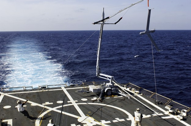 A Boeing Insitu ScanEagle UAVsis recovered at sea aboard the guided-missile destroyer USS Oscar Austin (DDG-79).