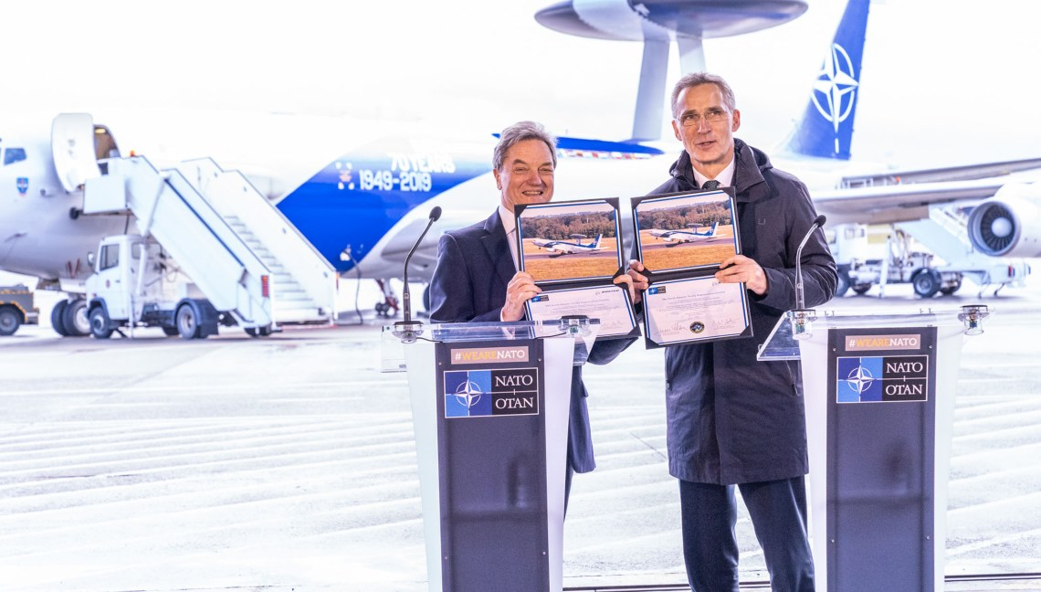 NATO Secretary General Jens Stoltenberg and the President of Boeing International, Sir Michael Arthur brief reporters after signing the $1 billion contract to modernize the Alliance's fleet of AWACS aircraft.