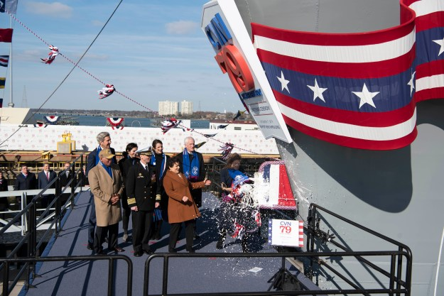 Caroline Bouvier Kennedy, President John F. Kennedy's daughter, former U.S. Ambassador to Japan and the ship's sponsor, christens the aircraft carrier USS John F. Kennedy (CVN 79), Dec. 7, 2019.