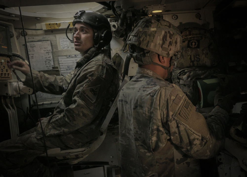 Staff Sgt. Jorge Almeraz (left), tank commander and Sgt. Antonio Bello (right), a canon crewmember, both with the Battery B, 4th Battalion, 1st Field Artillery Regiment, resets their stations after a nine round fire mission inside of a M109A6 Paladin during the Joint Strike Fighter Integration exercise, Nov. 7, at the Dona Ana Training Facility in New Mexico. The JSF Integration exercise tested multiple communications links between a U.S. Air Force aircraft and a U.S. Army artillery battery from the 1st Armored Division, to increase readiness across multiple domains. (U.S. Army photo by Staff Sgt. Brandon Banzhaf, 24th Theater Public Affairs Support Element)