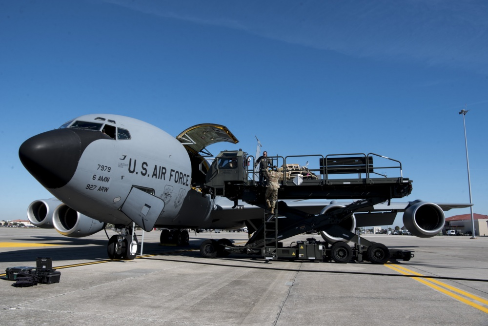 embers of the 6th Logistics Readiness Squadron and the 6th Operations Group load cargo onto a KC-135 Stratotanker aircraft at MacDill Air Force Base, Fla., Dec. 6, 2019. The cargo was loaded in preparation for a hisoric deployment of the entire 91st Air Refueling Squadron to Southwest Asia.