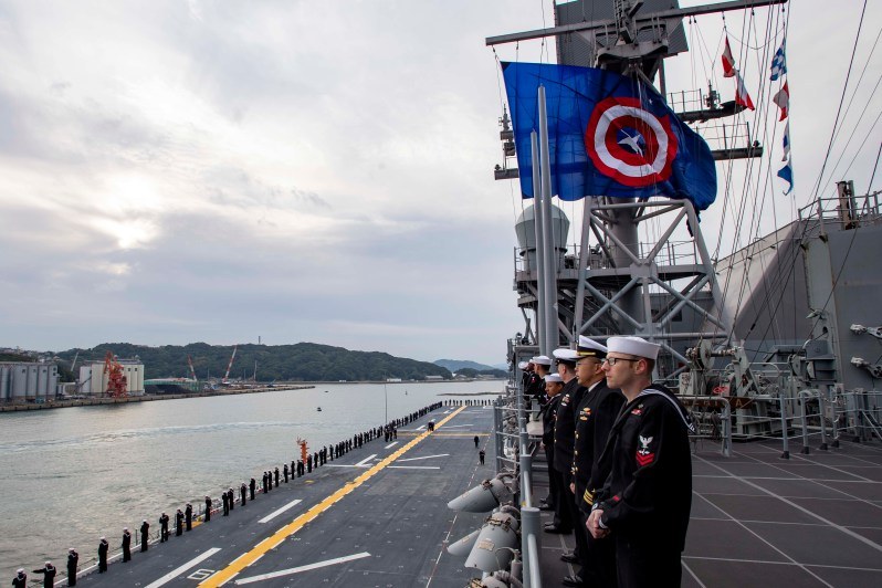 Sailors man the rails as the America-class amphibious assault ship USS America (LHA 6) arrives at Sasebo, Japan to join the forward deployed naval forces.