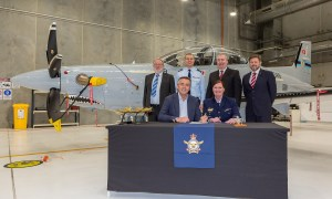 Minister for Veterans and Defence Personnel, the Hon. Darren Chester MP (r), and Air Force officer, Head of Air Force Capability, Air Vice-Marshal Catherine Roberts, sign the Certificate of Achievement at the final delivery ceremony for the new RAAF Pilatus PC-21s at RAAF Base East Sale.