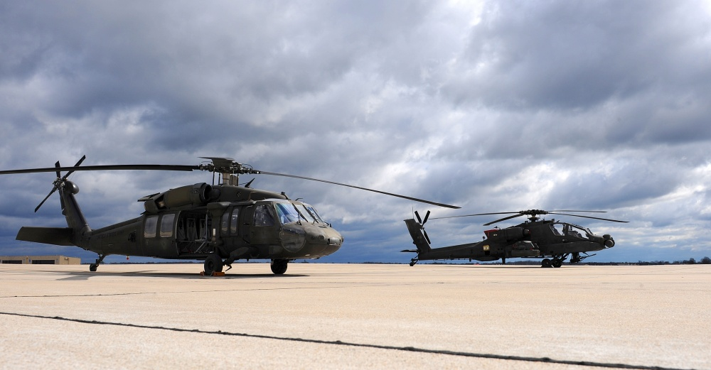 A Missouri Army National Guard UH-60 Black Hawk utility helicopter, left, sits next to an AH-64 Apache attack helicopter on the flightline at Whiteman Air Force Base, Mo., April 1, 2016. Black Hawk helicopters began arriving at the 1-135th Attack Reconnaissance Battalion in September of 2015 as part of the Department of the Army's Aviation Reconstruction Initiative. There are now 13 Apaches and 10 Black Hawks assigned to the unit.