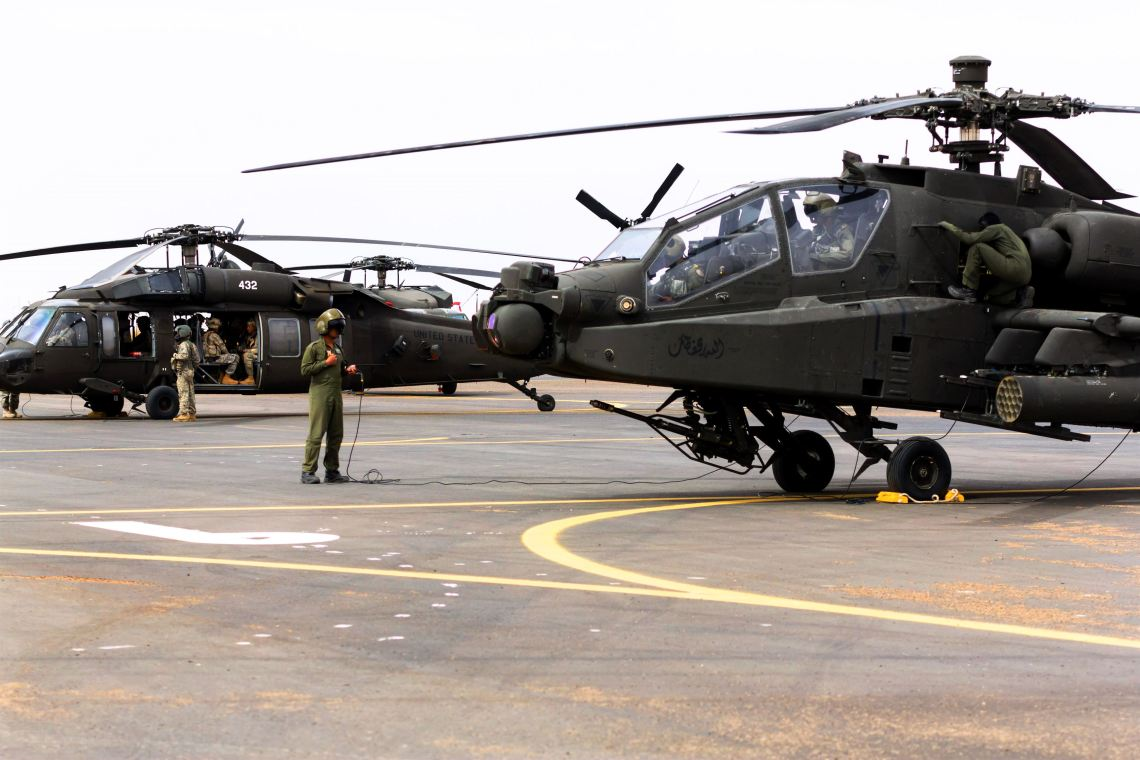 U.S. soldiers prepare AH-64 Apache and UH-60 Black Hawk helicopters before a practice joint air assault exercise with Saudi soldiers near Tabuk, Saudi Arabia,