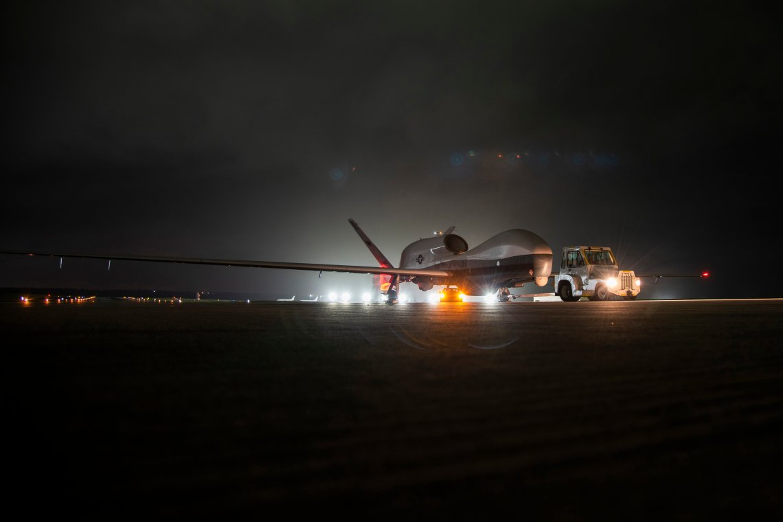 An MQ-4C Triton unmanned aircraft system (UAS) idles on a runway at Andersen Air Force Base, Guam after arriving for a deployment as part of an early operational capability (EOC) test.